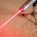 TITAN 650nm red laser pointer in action mountable on a tripod