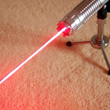 TITAN 635nm red laser pointer in action mountable on a tripod